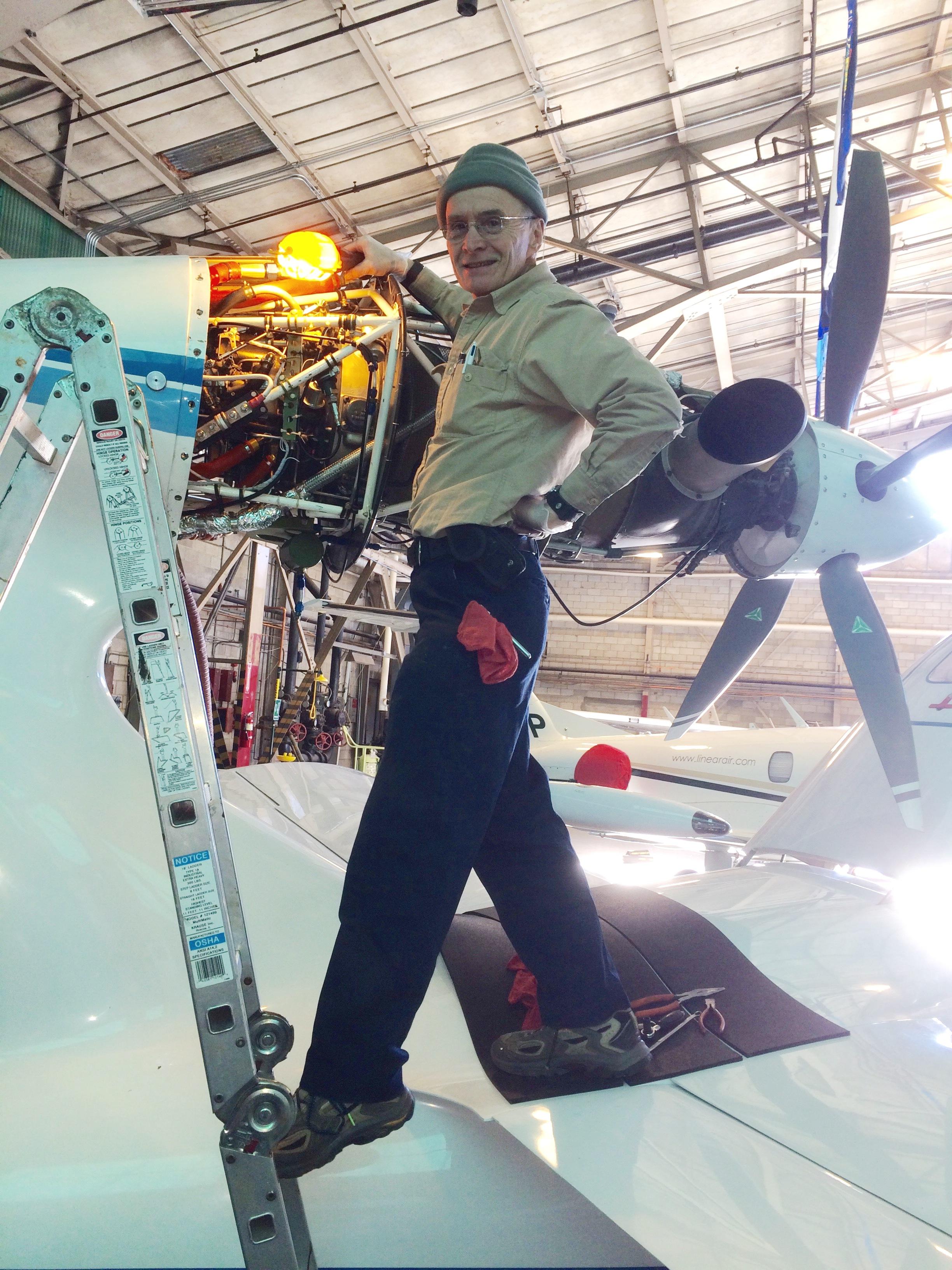 Repairman Steve inspecting his engine  - Super Seawind